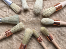 large bristle brushes for stippling wax onto canvas